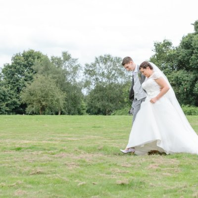 Norfolk wedding photographer – wedding couple walking