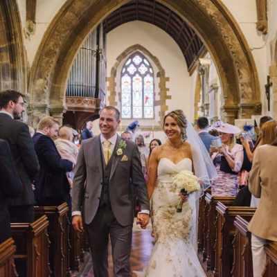 Norfolk wedding photographer – bride and groom leaving church