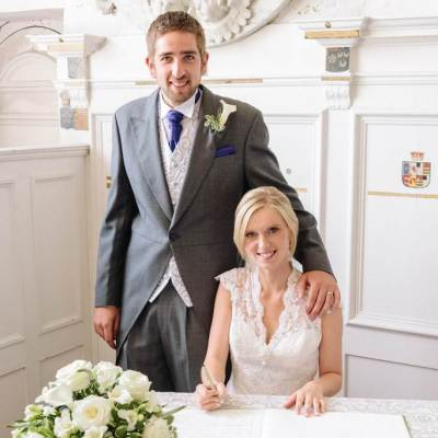 Norfolk wedding photographer – bride and groom signing register