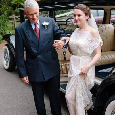 Norfolk wedding photographer – bride helping father out of the car