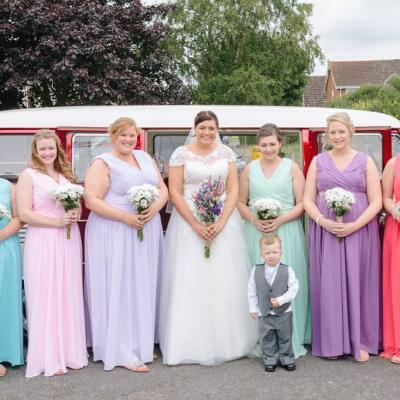 Norfolk wedding photographer – bride and bridesmaids with wedding car