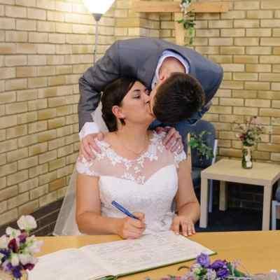Norfolk wedding photographer – bride and groom kissing