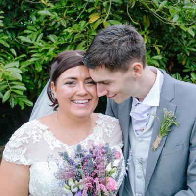 Norfolk wedding photographer – bride and groom cuddle
