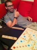 Passing time with old school Scrabble. Awkward thumbs up because I'm probably winning.