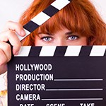 Female director with clapperboard