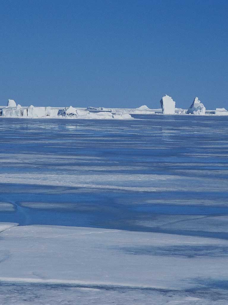 meltwater-ponds-on-sea-ice-off-coburg-island-nunavut-canada-arctic-warming-has-been-associated-with-a-rapid-decline-in-arctic-summer-sea-ice-extent-image-credit-sandy-briggs