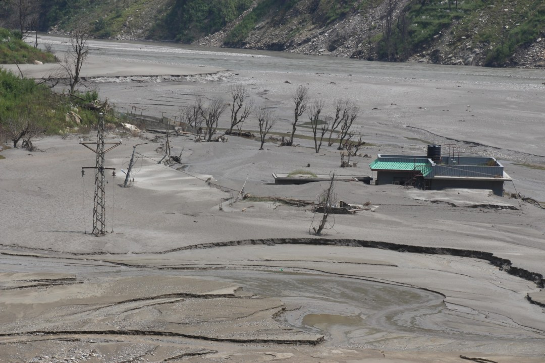 A house submerged as a result of a landslide that nearly took away the whole village