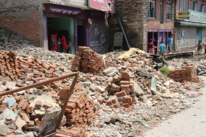 Bricks are stacked in every street, around every corner, ready for the rebuilding