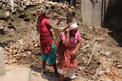 A team of women clearing rubble