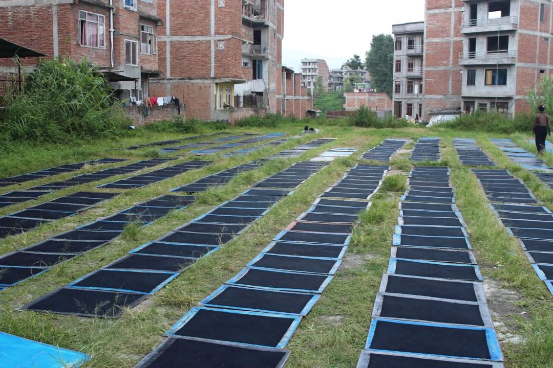 In the middle of suburban Kathmandu, a drying yard