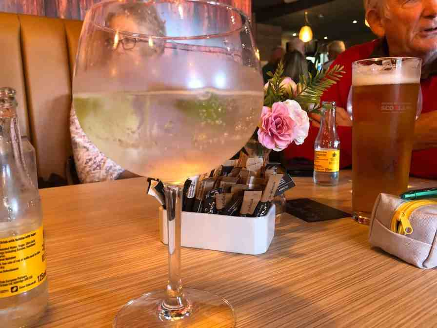 enjoying a glass of gin and tonic at Brew 74 bar