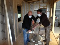 Simon and Stephen sawing Cellotex insulation