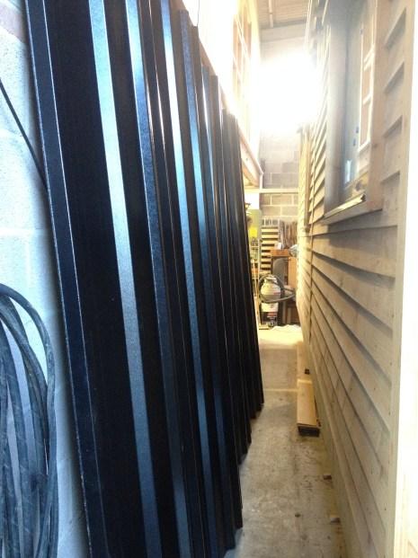 beautiful black plasti-coated box profile sheeting waiting to go on roof