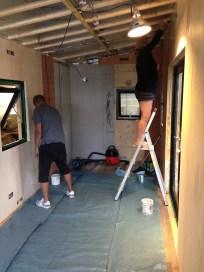 Karen and Leonard putting final coat of oil on walls