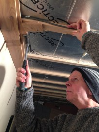 Master Craftsperson Adrian Hopper installing the first ceiling plank