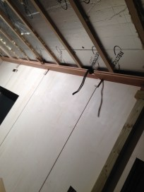 The first ceiling plank installed