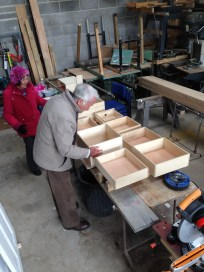 Royal visitors inspect drawer boxes