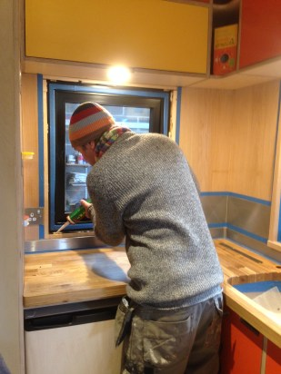 Stephen glues in the window frames