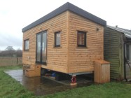 Cabin installed in new home experiences its first rainfall