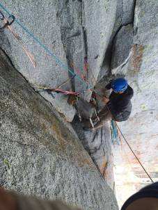 The belay above the corner: 2 fixed nuts, 2 fixed pins, and a yellow TCU