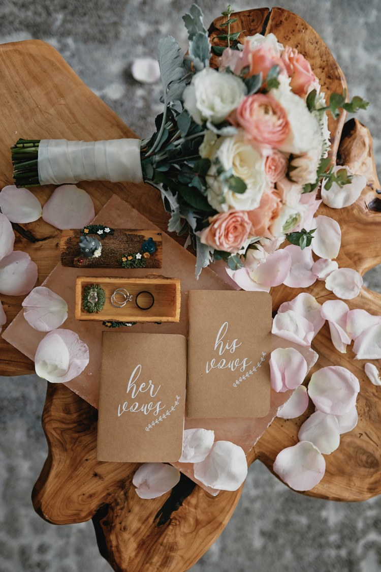 wedding vows rings bouquet flat lay