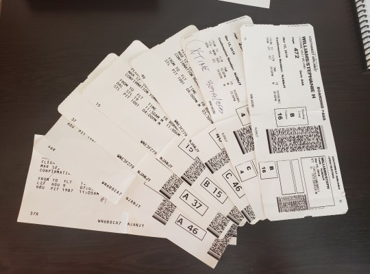 Photo of all 7 boarding passes from my travel day.