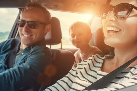 Family in car on road trip