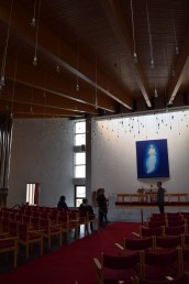 An austere interior, a floating Mary and Jesus and hundreds of suspended light bulbs.