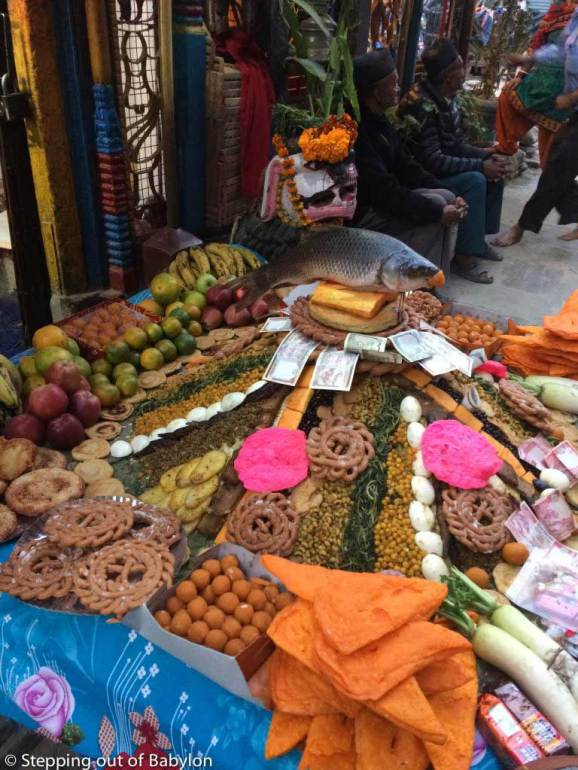oferings of food piles in from of a small temple during Tihar Festival. Kathmandu
