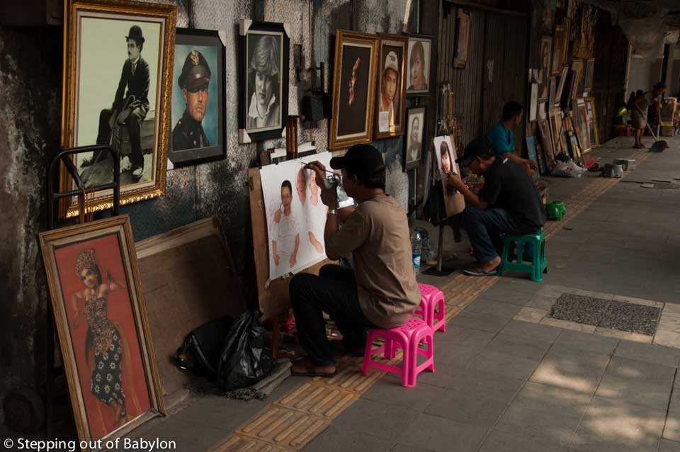many painters working on the canvas or simply selling paintings along Jalan Pintu Besar Selatan