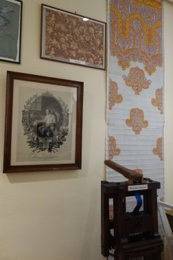 The portrait on the left is actually woven fabric. On the right is an example of a design drawn on graph paper.