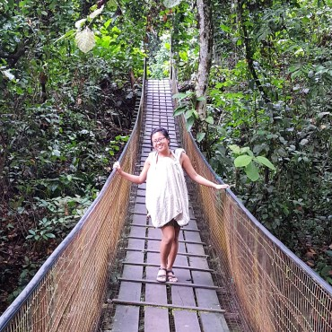 Crossing a suspension bridge in Borneo while breastfeeding and carrying Sophia in the Ergo