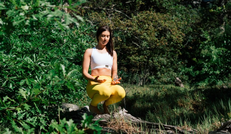 girl meditating in forest