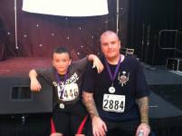 image of steve with kid after LA Stair Climb 2012
