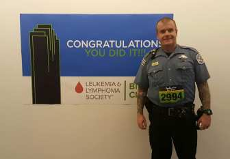 image of steve in cop uniform at a climb for dallas first responders