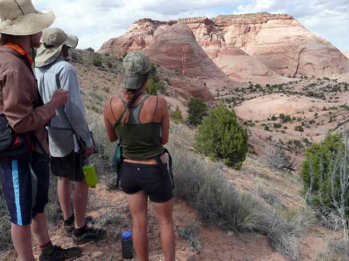 sun-kissed students look out over the sunny, martian landscape of Grand Staircase-Escalante National Monument