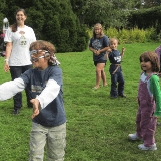 Blindfolded game with children