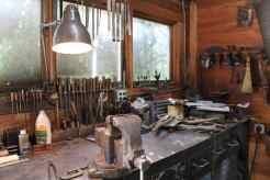 A well-lit work bench in the Blacksmithing class
