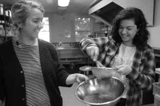 Photo of students making apple sauce