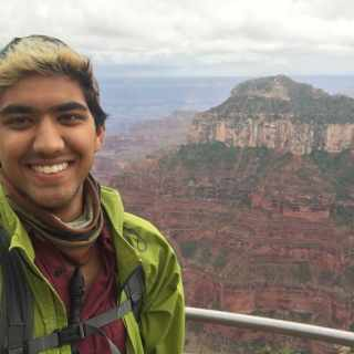 Kunal Palawat, a new admission counselor at Sterling College, a color photo of him with mountains and canyons in the background