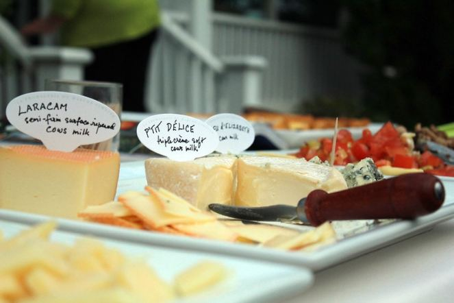 a spread of different cheeses with labels
