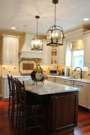 This kitchen features a complete remodel with brand new kitchen cabinetry, countertops, flooring, lighting, backsplash and appliances by Sterling Kitchen & Bath.