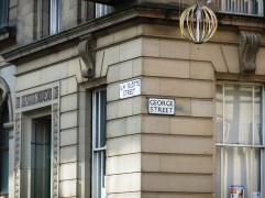 "Street signs - ""Charlotte Street"" and ""George Street"". I need to do some research as to who those two are and why those streets were named after them!"