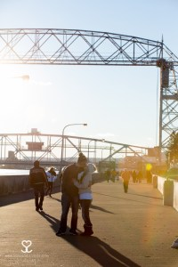 duluth arial lift bridge engagement kiss