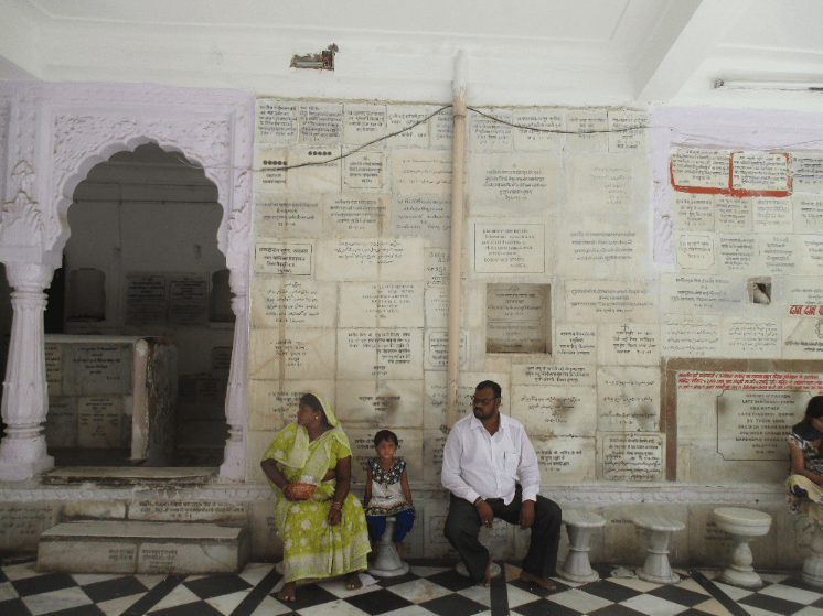The temple is covered in inscriptions memorialising family members.