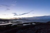 The lake at Þingvellir National Park. It is sunrise for around 2 hours at the end of December.