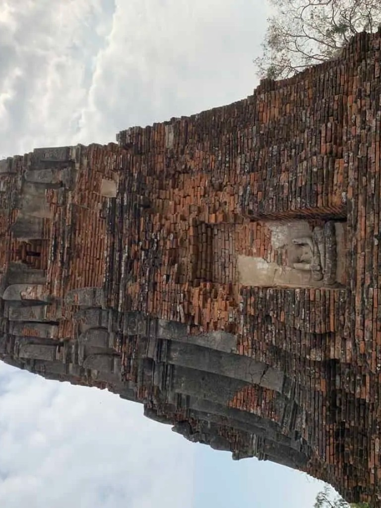 stupa contains a headless Buddha