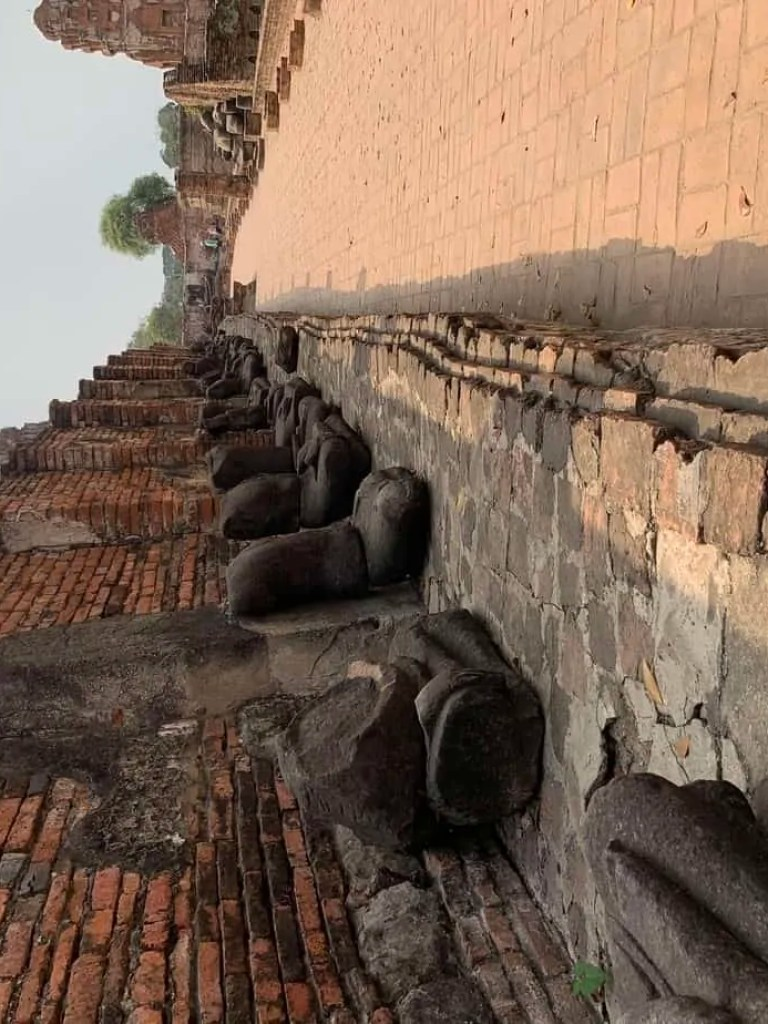 courtyard of Buddha statues whose head were removed