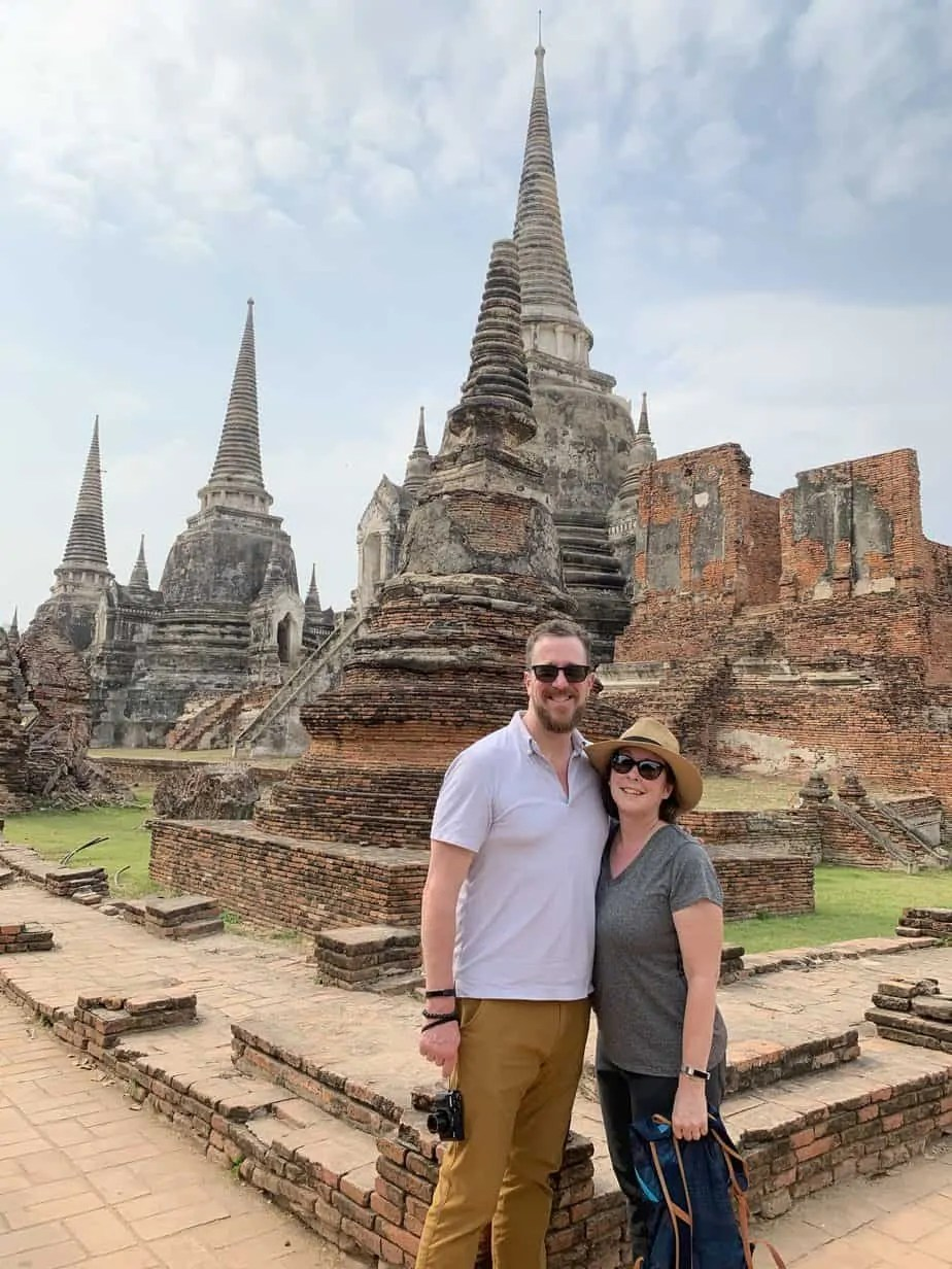 Steve and Noelle in front of stupas and ruins