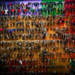 A wall full of different keys